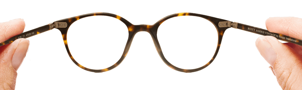 Beartooth Vision Center Glasses Being Held by Hands